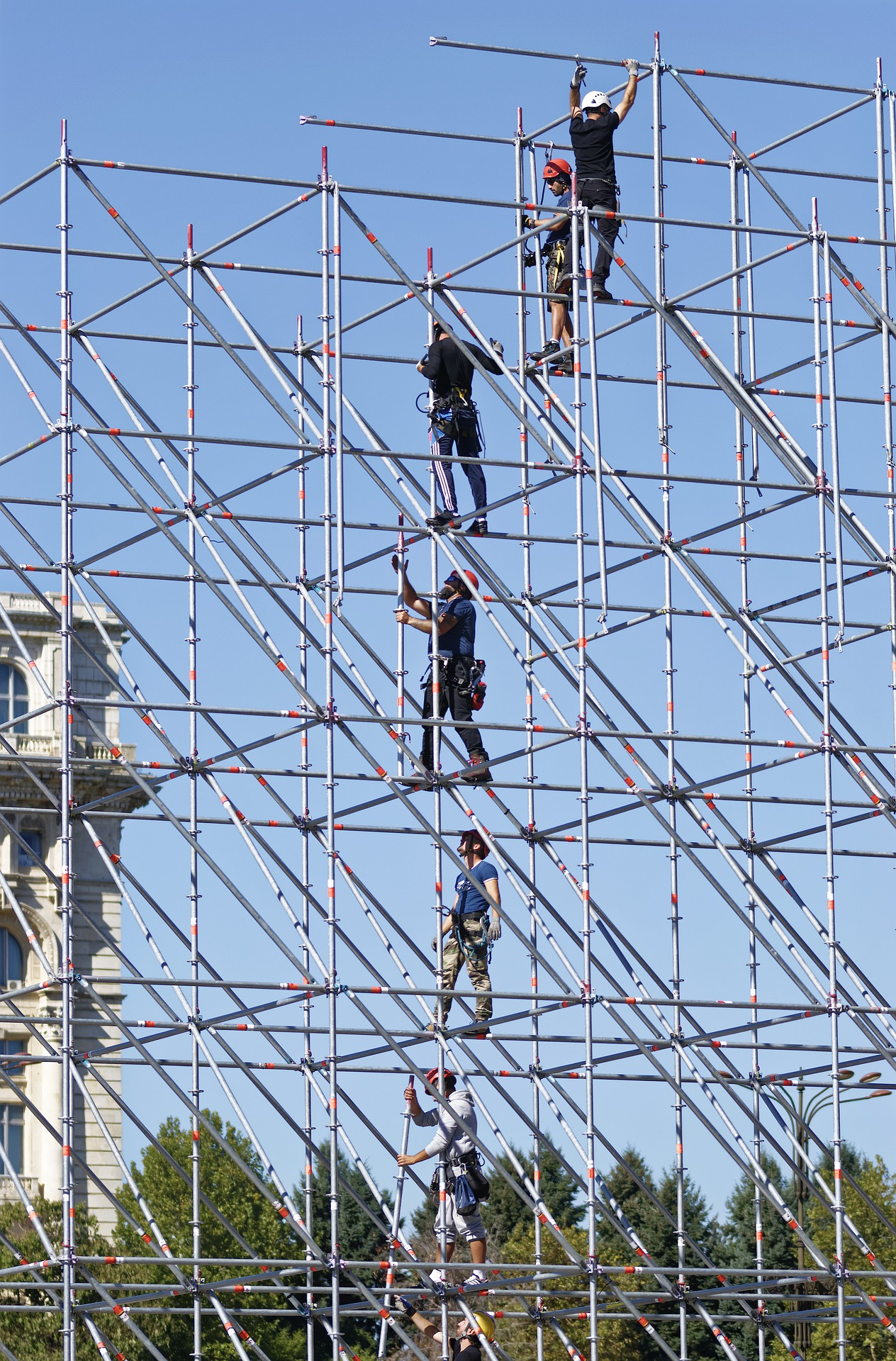 Men working while in a scaffold